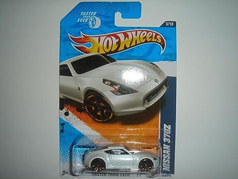 Amazon Com 2011 Hot Wheels Nissan 370z White 143 244 Toys Games