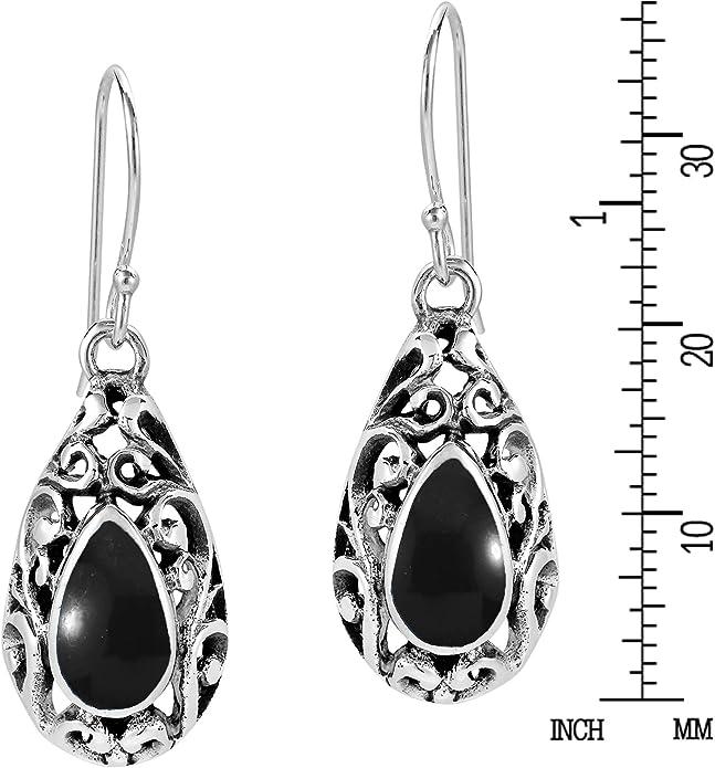 Gunmetal fishhook earrings 2 12 inch drop. Patterned metal earrings with handmade black 8mm resin and ink bead