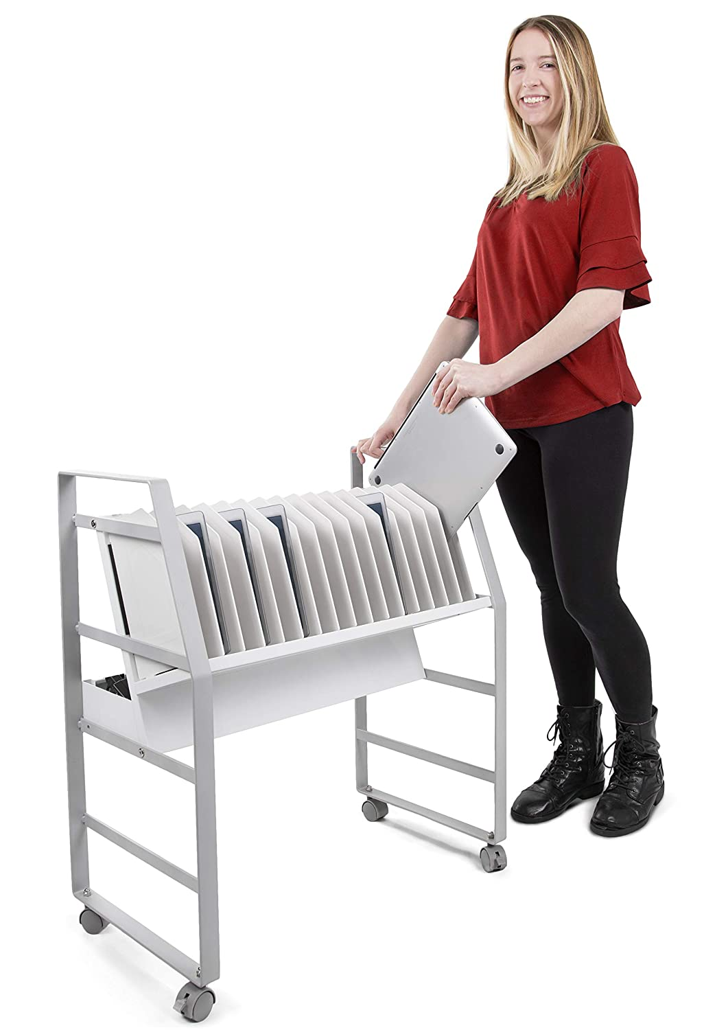 Woman putting a computer in a silver computer cart.