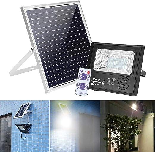 Foco LED solar para jardín con 100 luces LED, IP 67, iluminación solar para exteriores con mando a distancia, altavoces HiFi y función Bluetooth, panel solar de 8 V y 18 W: