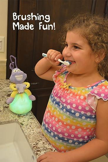 Formación Ayuda de cepillado dientes para niños, luz de peluche Toothbrushing temporizador, compañero Storybook hace la vida más fácil para padres: ...