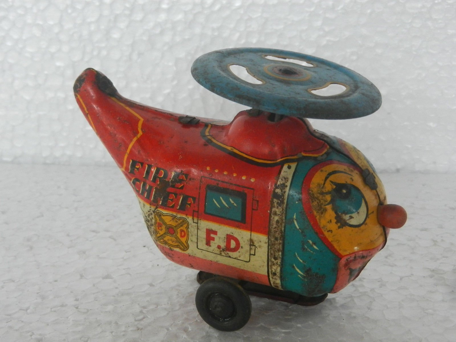 Vintage Wind Up Fire Chief F.D Helicopter Litho Tin Toy