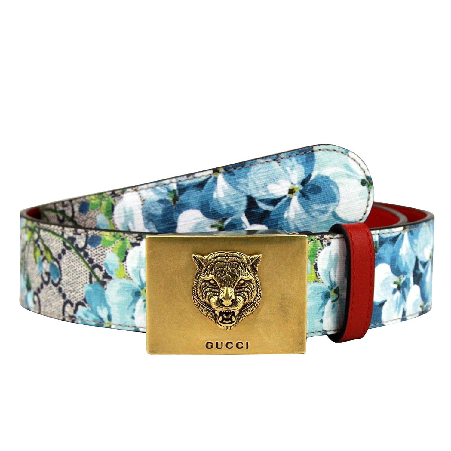 6655686ef5a Amazon.com  Gucci Unisex Gold Tiger Blue GG Supreme Coated Canvas Bloom  Print Belt Buckle 434559 8492 (80 32)  Clothing