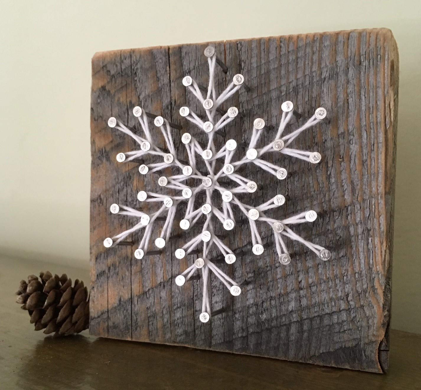 Sweet and small'Frosty' snowflake gifts. Rustic holiday string art A unique gift for Christmas, Hanukkah and winter weddings. Perfect for ski cabins. Made in Maine.