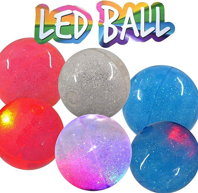 Pelota de goma con luz LED multicolor, 6 cm aprox.: Amazon.es ...