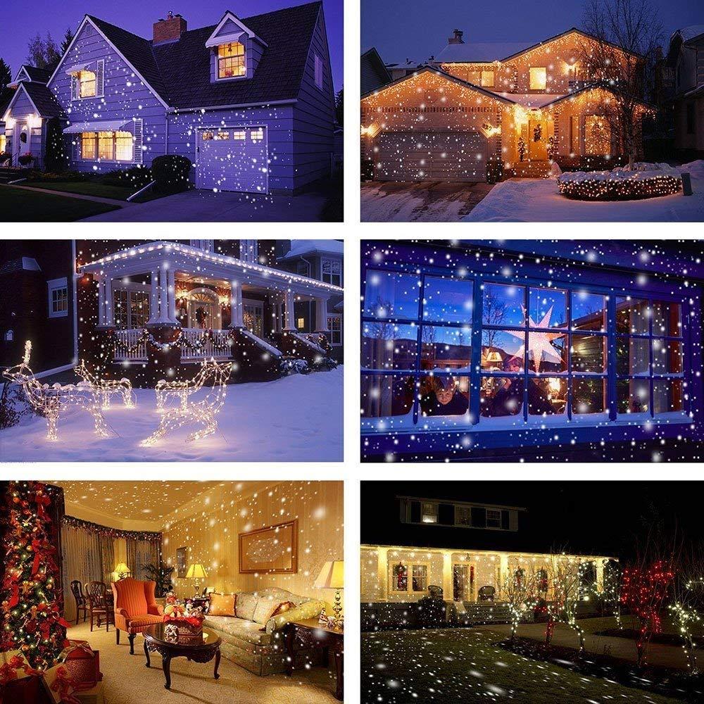 Decorazioni natalizie. Proiettore LED di Halloween. Lampade del paesaggio del riflettore rotante delle precipitazioni nevose bianche dei fiocchi di neve