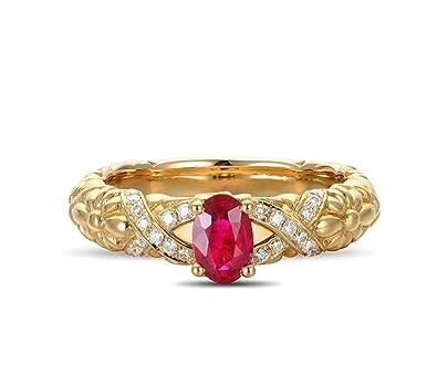 bague or 18 carats et rubis