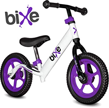 side facing purple and white bixe extreme light balance bike