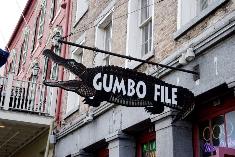 Trade sign showing an alligator outside a retail food establishment that specializes in gumbo in New Orleans Louisiana Poster Print (18 x 24)