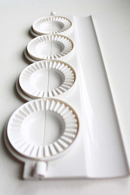 small pierogies, dumplings, uszka press/maker. Makes four small pierogies at once