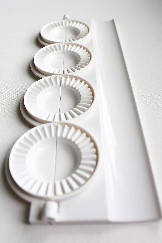 pierogi, dumpling, uszka press/maker. Makes four pierogies at once