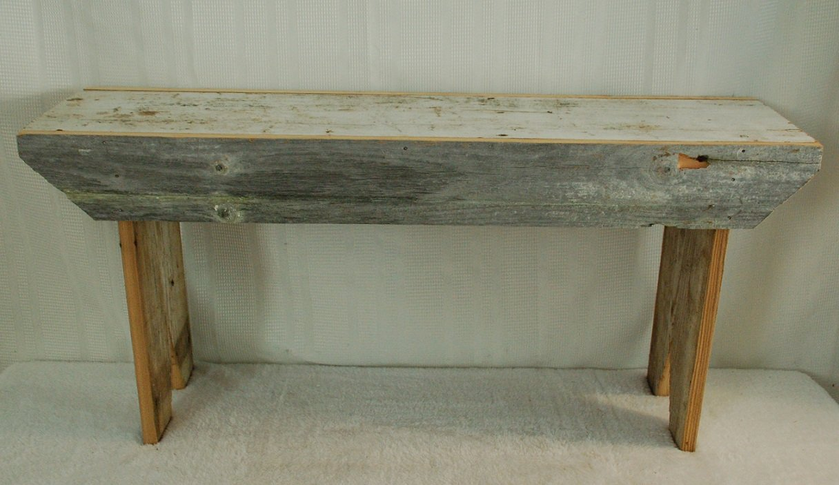 Rustic 3 Foot Barnwood Bench. This Country Bench Seats Varies in Width From 8 - 10'' and Stands 16'' Off Ground. Made From Antique Barnwood in Excess of 100 Years Old. This Rustic Primitive Bench Is a Great Addition to Your Home and Garden Landscape Design.