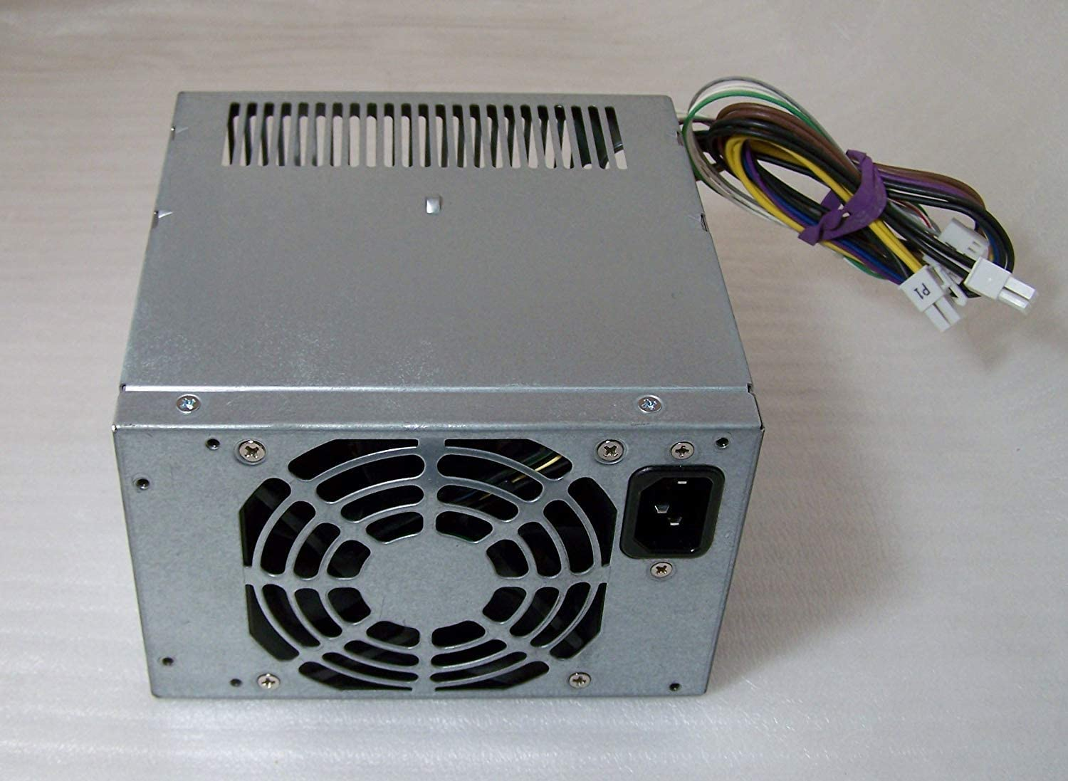 HP 613764-001 Power supply unit (PSU) - Four 12VDC output connections, 320-Watts total power - For Convertible Microtower (CMT) series (EPA 90%)