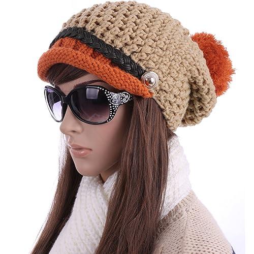 Mujer elegante Contraste de color Pom Pom Top Design invierno gorro de punto