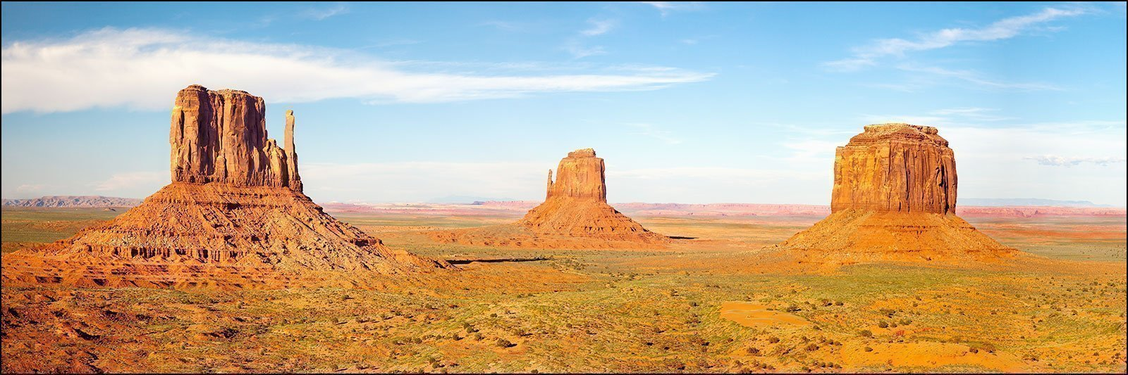 12 x 36 inch Panoramic art decor photograph of classic Southwest red buttes used in many movie westerns in Monument Valley, UT.