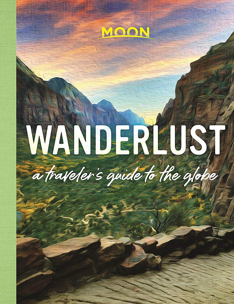 An image of a book entitled Wanderlust, with valley and mountains as cover photo.