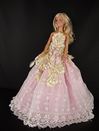 A Light Green Ball Gown with Lots of Sparkle Made to Fit the Barbie Doll