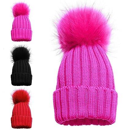 7b780a78fdb Girls Single and Double Pom Pom Winter Hats Caps Kids Beanies Single Pom  Double Pom Cosy Knitted Beanies (1 POM POM HAT PINK)  Amazon.co.uk  Kitchen    Home