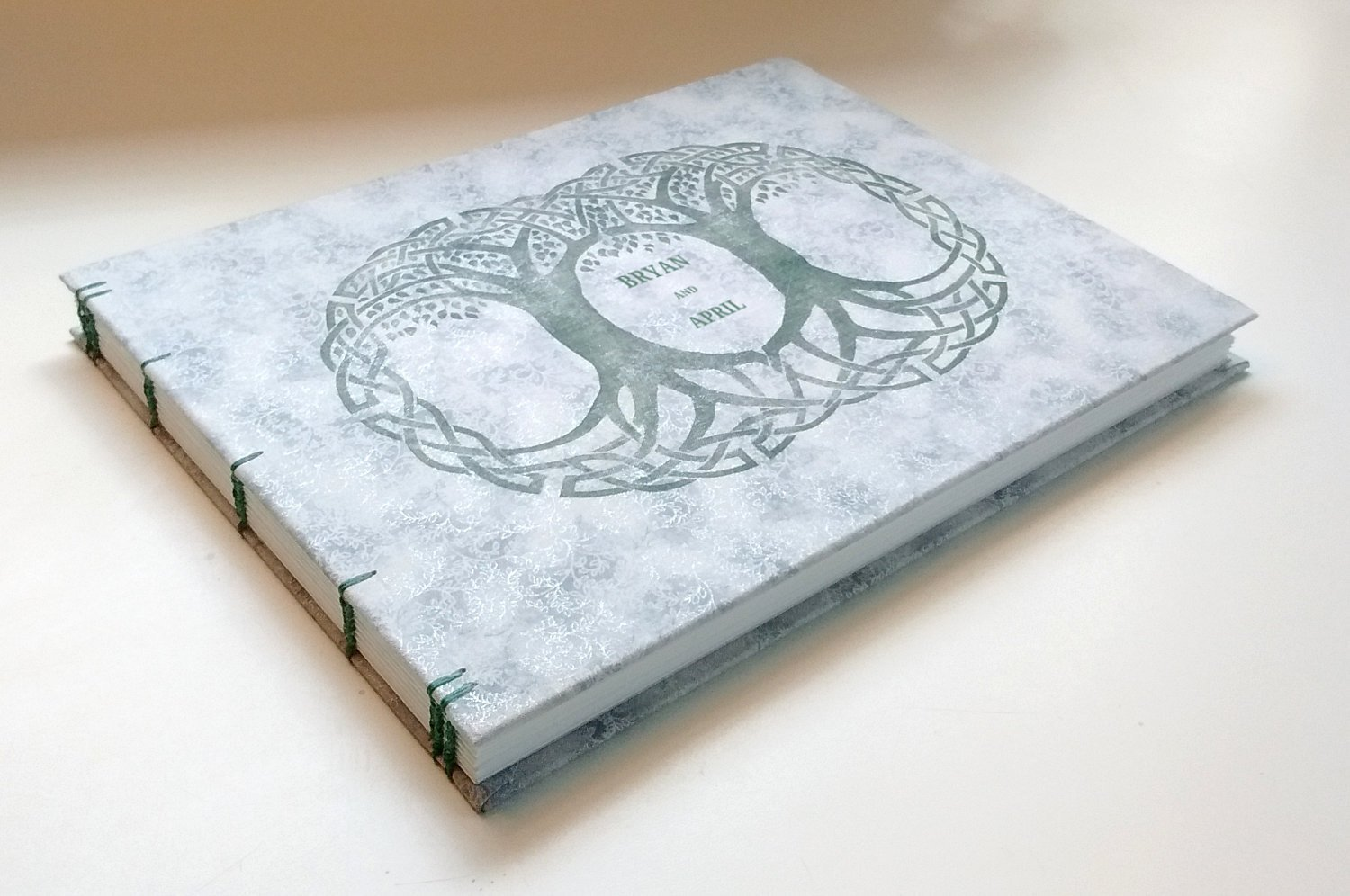 Personalized wedding album, guest register, guest book, photo album, hand-bound with Coptic stitching in wood and cloth, with original double Celtic Tree-of-Life artwork on cover.