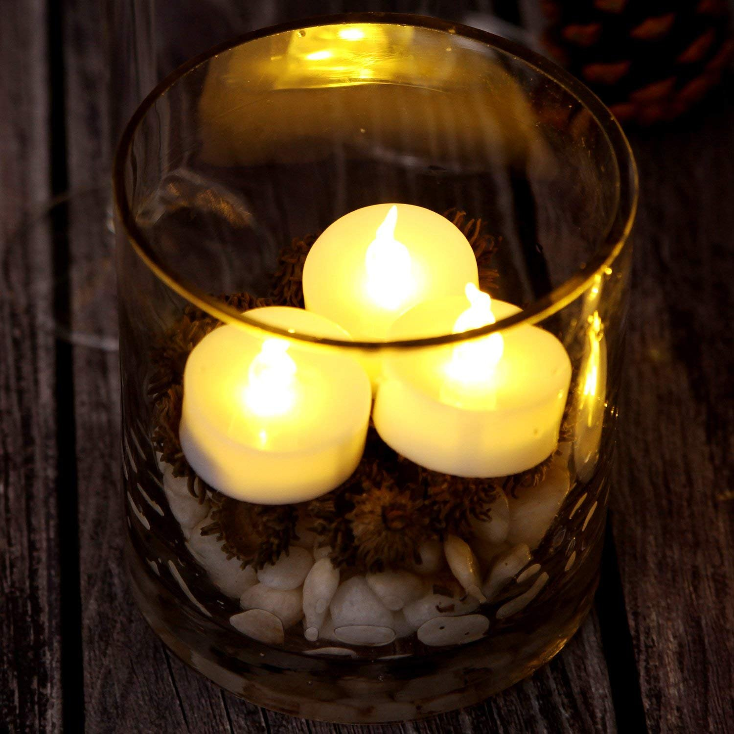AGPtek No flicker Flameless LED Candles Battery-Operated Long Lasting Tealights for Wedding Holiday Party Home Decoration 24pcs(Warm White) by AGPTEK