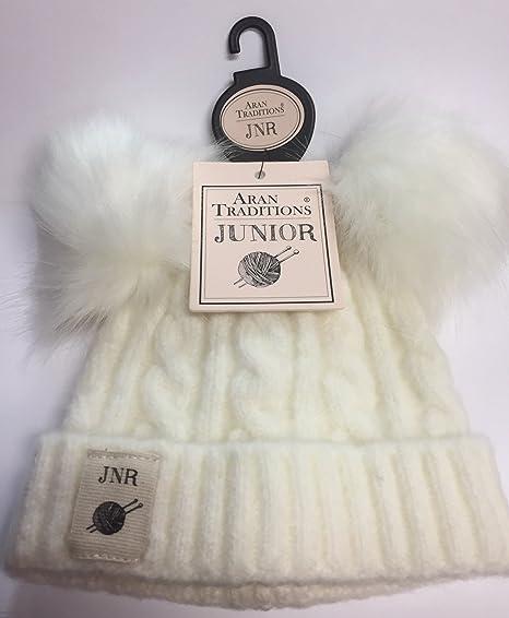 15d63cc5fb5 Image Unavailable. Image not available for. Color  Kids Aran Mini Cable  Double faux fur Pom Pom Hat - Cream