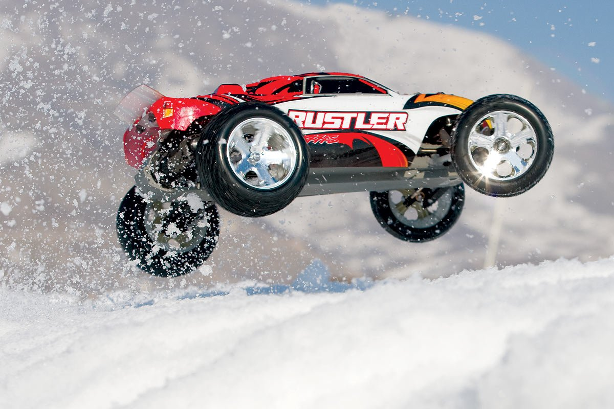 Traxxas RTR 1 10 Rustler With Water Proof XL 5 And 7 Cell Battery Charger Red Amazonca Toys Games