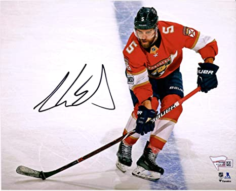 Aaron Ekblad Florida Panthers Autographed 8 quot  x 10 quot  Red Jersey  Skating with Puck Photograph 0452d4f0c