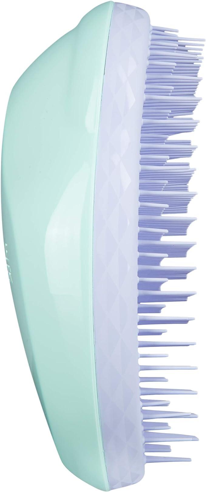 cepillo masajeador de pelo para meter el dedo