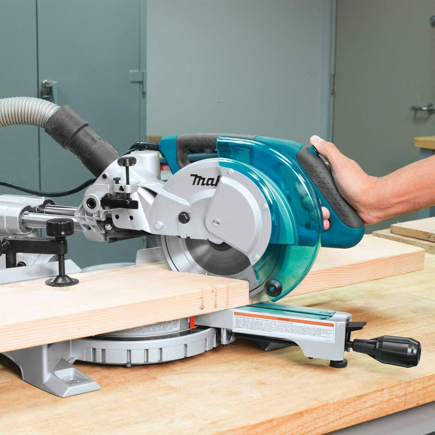 Working in a wood shop with Best Compact Miter Saw