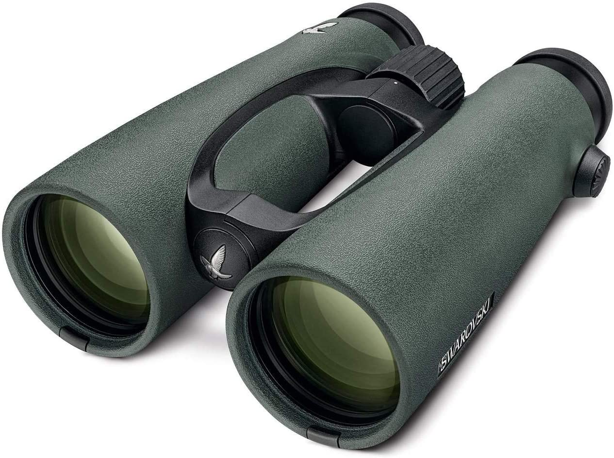 A pair of green binoculars with green reflection coming from the lens of it.