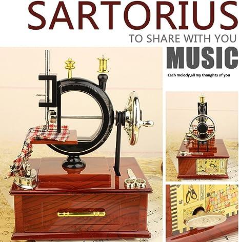 Caja de música, dinglong 1 pc Mini Vintage máquina de coser caja de música niños juguete Treadle Sartorius juguetes Retro regalo de cumpleaños Carlos Mesa Décor decorativo: Amazon.es: Bebé