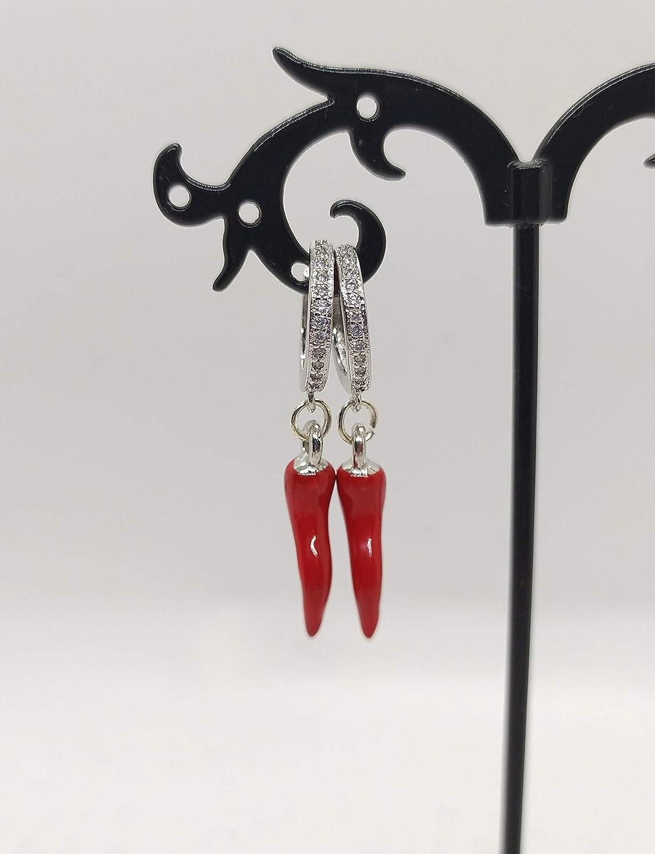 Orecchini cerchio con zirconi bianchi realizzati a mano colore argento e cornetto rosso portafortuna.