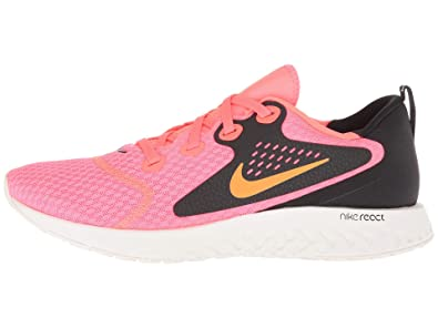 the best attitude b5312 93997 Nike WMNS Legend React, Chaussures de Running Compétition Femme,  Multicolore (Flash Crimson