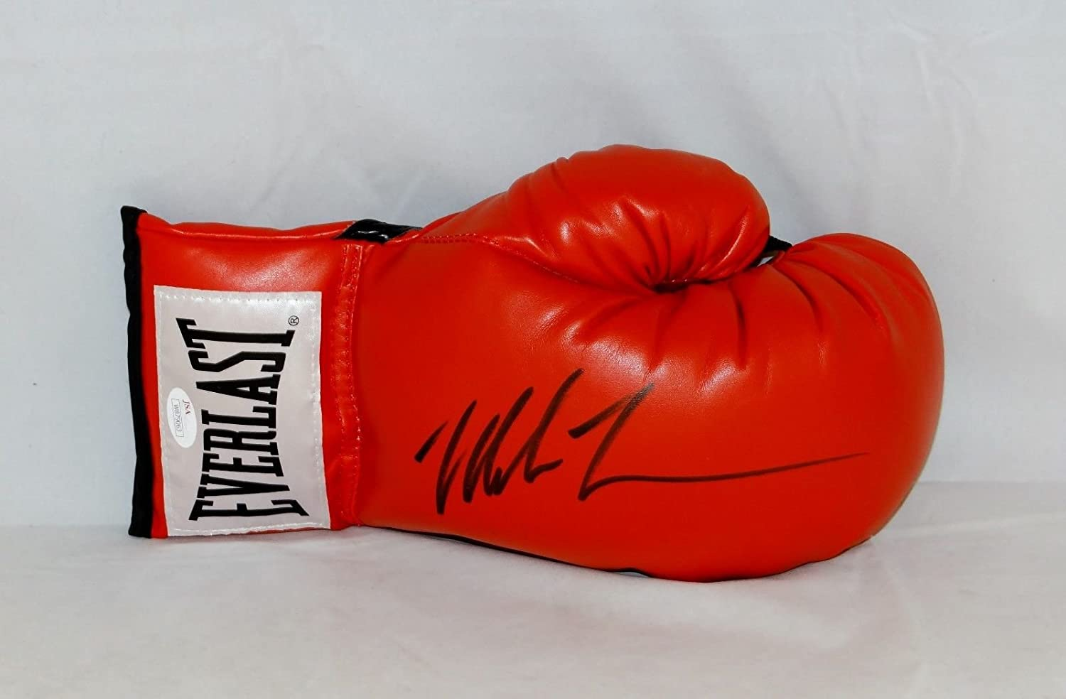 Mike Tyson Autographed Red Everlast Boxing Glove Black- JSA W Auth