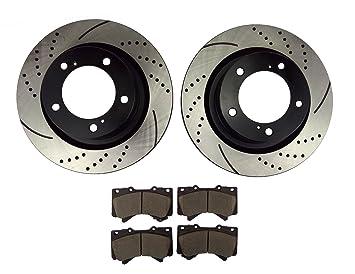 atmansta qpd10002 Kit de freno delantero con perforado/ranurada rotores y pastillas de freno de cerámica para Toyota Land Cruiser Sequoia Tundra: Amazon.es: ...