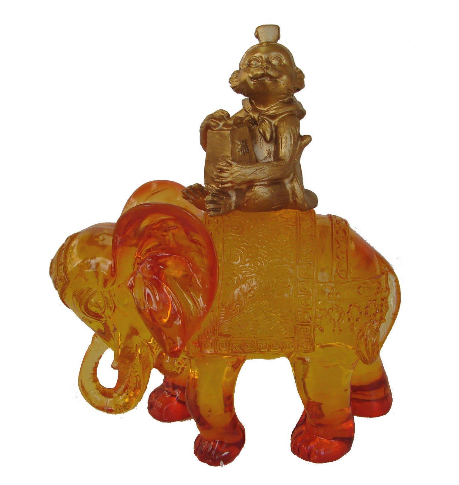 Monkey Holding A Prosperity Bag On Elephant