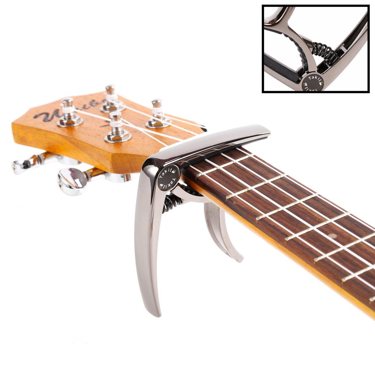 TAKIT Cejilla para Guitarra Acústica y Eléctrica – Apta para Ukelele, Banjo y Mandolina – Profesional, Alto Rendimiento, Manejo Con Una Sola Mano Estilo Gatillo fabricada con Aleación de Zinc – Plata GC4