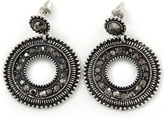 Silver tone ornate drop bead with dark blue crystal accents