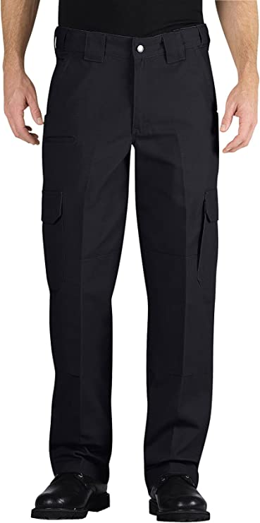 Image of a man standing wearing the Dickies Tactical pants, color midnight blue.