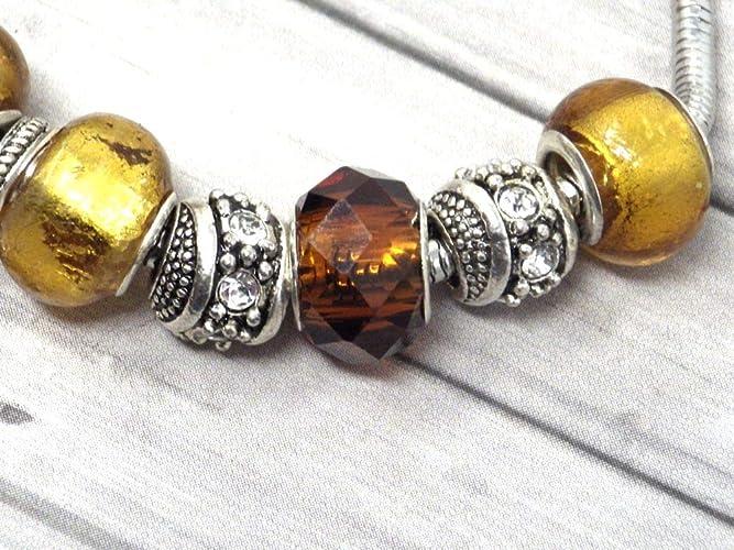 Bracciale Charms color oro da donna in acciaio Thurcolas modello Manhattan con pendente trifoglio con cristalli