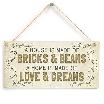Amazon.com: Una Casa está hecha de ladrillos y vigas de una ...