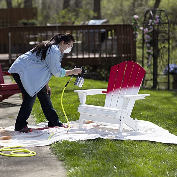 Paint furniture using a paint gun and an air compressor