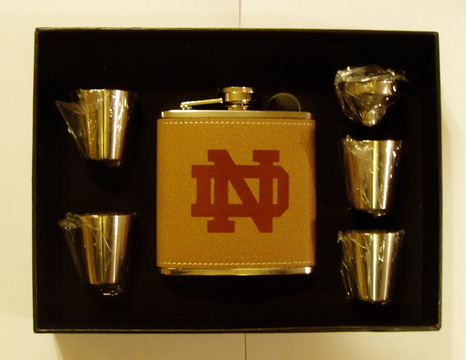 Notre Dame Leather Engraved 6 oz Stainless Steel Flask with 4 Stainless Steel Shot Glasses and Funnel In A Black Presentation Box