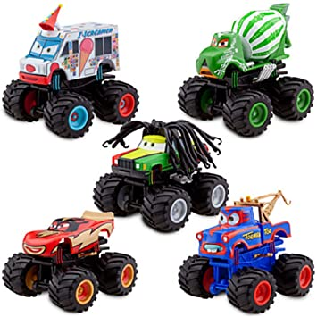 Amazon Com Disney Deluxe Monster Truck Mater Figure Set Toys Games