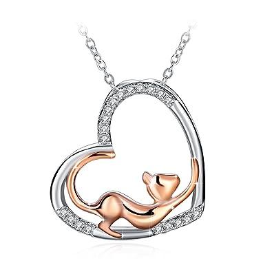 Pendentif en cœur et petit chat en argent blanc et chat en or rose diamant