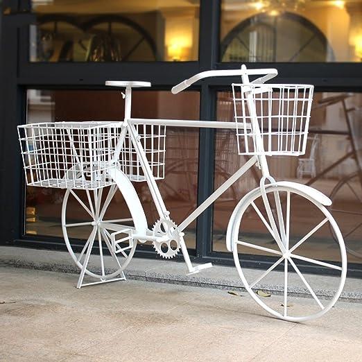 Bicicleta de hierro forjado de época decorado marco de flores ...