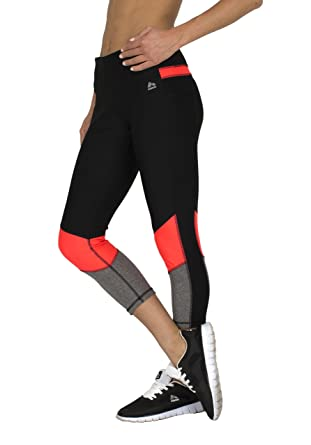 d317640f2cceb3 RBX Active womens Color Block Capri, Black / Coral Combo, Medium at Amazon  Women's Clothing store: