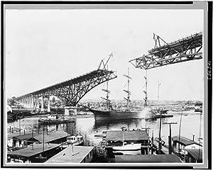 1931 Photo A ship, Monongahela, passing under Aurora Bridge, Seattle, Washington. Center truss of bridge has not yet been installed Location: Seattle, Washington