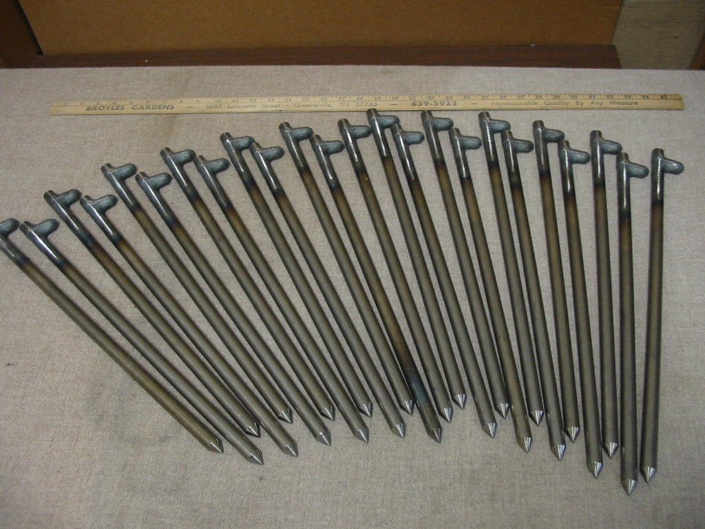 A 24 Pack of 18'' long heavy duty steel tent stakes! by Monk Industries