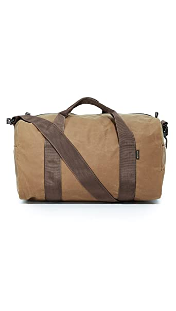 7b33398415 Filson- Style 70110 Tin Cloth Duffle Small (Tan)  Amazon.ca  Luggage ...